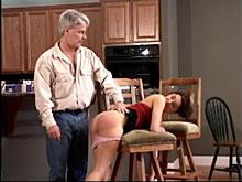 Spanking bent over a chair 