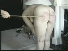 Spanking with a cane